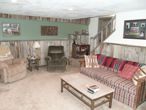 The downstairs with couch and two recliners